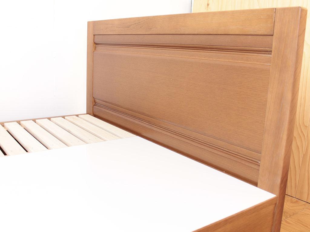 洋服タンスの扉を横向きにして生かしたベッドのヘッドボード